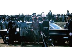 Photographs: His Majesty, King Sobhuza II Independence Day, 1968. Sir Francis Loyd, the British Resident Commissioner welcomes the King, Sobhuza II to the independence ceremony at Somhlolo Stadium. Both men wear feathered headdresses. (Photo: George Murdoch)