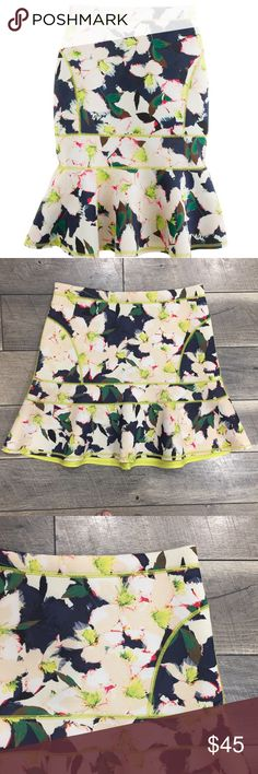 J. Crew Surf Skirt in Cove Coral Not just for surfer girls. Structured neoprene looks even better on dry land in this bold graphic floral. The flared silhouette is finished with neon seaming and a sporty back zip.  Size 8. Excellent used condition. Poly. Back zip. J. Crew Skirts Midi