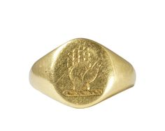 Superb gold signet ring with an open palmed hand intaglio carving to the face. Modelled in 18ct gold.