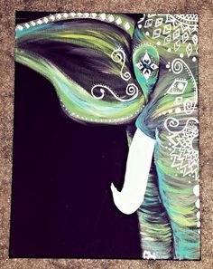 Custom Painted Bohemian Elephants with tribal prints and neon accents. This piece will brighten any corner and add character to your space to make