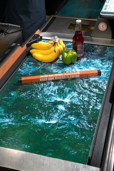 Keep our rivers flowing. Use only what you need. Denver Water Supermarket Conveyor Belt Ad by Sukle Advertising & Design