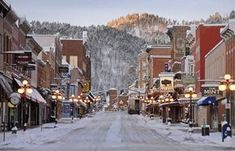 Is it wierd that I would love to visit Deadwood, South Dakota? >>>This adorable historic gaming town is tucked into the Black Hills in a little gulley. You can to go Mt. Moriah Cemetery and see the graves of Calamity Jane and Wild Bill Hickock. North Dakota, Deadwood South Dakota, South Dakota Vacation, South Dakota Travel, Nebraska, Missouri, Places To Travel, Places To See, Travel Destinations