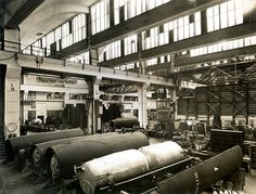 Steampunk rockets in production at the Peenemunde rocket factory, Germany, Rocket tanks are seen in the foreground, the aft parts of the rockets are on the left, and the nose cones are in the background on the right. The Third Reich, Historical Images, Luftwaffe, War Machine, World War Two, First World, Ww2, Aviation, Germany