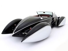 "Deco Rides 'Bugnotti' (2003) Inspired by Auburn, Delahaye and Bugatti design elements, the car melds a Chip Foose designed Deco Rides Generation II Auburn Boattail Speedster body, modified and streamlined from the original Auburn design of Al Leamy, Gordon Buehrig and Vince Gardner. The fully-enclosed chipmunk-cheek ""pontoon"" fenders, styled after a Figoni & Falaschi Delahaye Type 135 by Terry Cook. A custom-sized Bugatti Type 57 grille is topped with a replica Hispano Suiza stork"