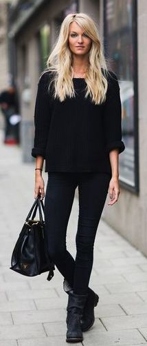 rolled up loose sweater sleeves, leggings, boots