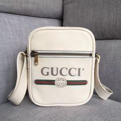 a1899c2cd547 Gucci Leather Print Messenger Bag 523591 -Size  cm -Calf leather with Gucci  vintage logo -Brass hardware -Front zipper pock. Anna Whitney · Gucci Purses  ...