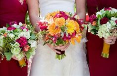 Touch of orange in bouquet with raspberry dresses is beautiful!!