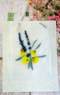 Pressing flowers using waxed paper
