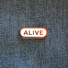 ALIVE (PRE-SALE) SOCIAL ALERT PIN Artist designed enamel pins for common physical & psychological situations  For everyone who has survived