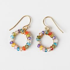 I like these colorful earrings! I also like that they are circle earrings. Circles are neverending and thats how friends and lovers should be!