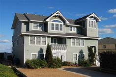 COAST AWHILE, #313 l Duck, NC - Outer Banks Wedding and Event Home l Oceanfront home providing 7 master suites, elevator, recreation room, home theater, den, loft with card table, heated pool, hot tub and direct beach access. l www.CarolinaDesigns.com