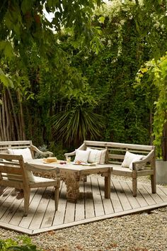 Discover garden room design ideas on HOUSE - design, food and travel by House & Garden. Wooden benches encircling a table, make for a convivial outdoor seating area.