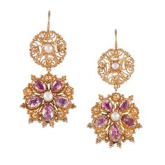 Cannetille Gemstone Gold Earrings. Crafted of 18k yellow gold, these fine antique earrings are a fabulous showcase of the hand craftsmanship that dominated the mid-19th century. Measuring 1 3/8 inches, these sweet earrings are a demure size, allowing for daytime- or evening wear. They are decorated with foiled pink topaz and seed pearls- the ultimate combination of feminine gemstones! c 1860
