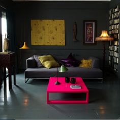 love the dark walls and yellow..and the pink is so unexpected