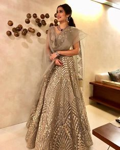 Sagarika Ghatge in a gold silver Falguni Shane Peacock Lehenga. Click on picture to see lehenga price. #Frugal2Fab