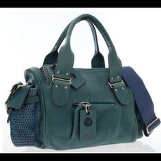 """Rare Chloe Teal & Blue Leather Satchel Bag Chloe leather satchel w/ silver feet, woven leather details, pockets w/ teal leather closure. Adjustable shoulder strap & silver zip closure. Brown canvas interior featuring one silver zip pocket w/ a teal leather zipper pull. 17"""" W x 10"""" H x 4"""" D, 5.5"""" Handle Drop, 20"""" Adjustable Shoulder Drop Light scratching on leather and  hardware, darkening to corners, the piping trim is lightly worn, interior shows lightening near the base. dustbag…"""
