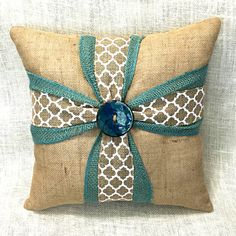 Your room will look so lovely when accented by this beautiful burlap cross pillow! Whether for you or a special friend, this unique cross pillow will surely delight. Featuring an aqua/turquoise burlap