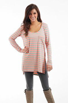 """Night In Tunic, Peach/Mint $36.00 This top feels like your PJs, but with way more style! The long tunic has horizontal stripes, a scoop neck and a pocket on the front, plus it's cut from incredibly soft material! Throw it over leggings and boots for a look thats cute but oh-so-comfy!   Fits true to size. Miranda is wearing a small.   From shoulder to hem:  Small - 28""""  Medium - 29""""  Large - 30"""""""
