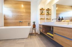 Bathroom<timber feature wall<recessed timber shelves