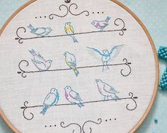Boho, hand embroidery patterns, feather embroidery, boho nursery decor by NaiveNeedle  FINISHED SIZE: approx 6x5 (15 cm x 13 cm) - shown here in a painted 8 (20 cm) embroidery hoop.  THIS 6-pages PDF FILE INCLUDES: 1 Design Instructions to Transfer Image Instructions for Embroidery 1 Tracing Pattern 1 Reversed Tracing Pattern Embroidery scheme ( DMC thread colours and number of strands )  Stitching guide   How to transfer the pattern on the fabric?  In attached instructions you get a few…