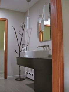 Thanks to Darlene in Michigan for sharing this great photo of our Metal Tree Coat Rack in her newly remodeled bathroom!