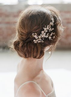 romantic bridal updo featuring the Hanami Ornament from @BHLDN | via: style me pretty