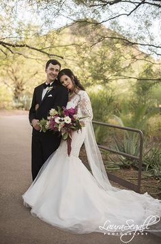 Bride and groom desert portrait session with jewel toned flowers.   http://www.segallphotography.com