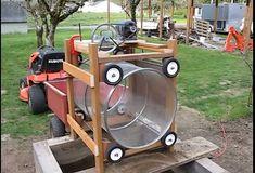 Soil Trommel by David Waltman -- Homemade soil trommel constructed from lumber, metal hoops, metal screen, wheels, pulleys, and an electric motor. http://www.homemadetools.net/homemade-soil-trommel