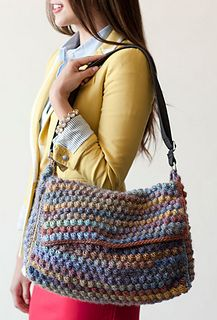 Carry books, crochet supplies, and more in this colorful designer-inspired bag.