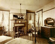 Bedroom 1910's look light fixture! Fireplace! Beds! Windows!!!