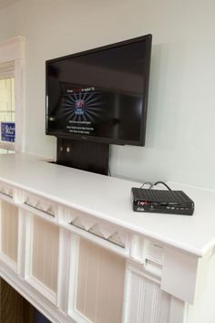 Learn how to build a TV lift discreetly tucked behind a fireplace mantel.