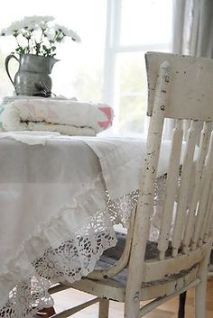 love the look..chippy chair...vintage linens~~~~~~~~~~~~~