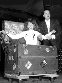 Orson Wells and Rita Hayworth perform magic tricks at The Hollywood Canteen