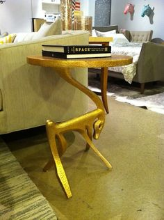 Dwell Studios featured creative ways to stand up a side table – A four-legged friend helps hold this one up. #hpmkt