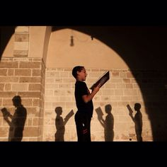 Palestinian boys read Quran at a Mosque in Gaza City on the third day of the Muslim fasting month of Ramadan, on July 1, 2014. Muslims around the world celebrate Ramadan, the holiest month in the Islamic calendar, in which they abstain from eating, drinking and conducting sexual relations from sunrise to sunset. By Wissam Nassar @wissamgaza #wissamgaza