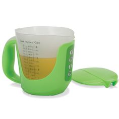 """The Talking Measuring Cup...This is the measuring cup that verbally announces the volume of wet or dry ingredients, eliminating the need for cooks to estimate by eye. When set in its base, the cup states how much has been poured into it in a clear female voice—1 1/4 cups is spoken as """"one and one-fourth cups"""". Tare function lets chefs add multiple ingredients without emptying the cup."""