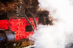 Steam And Iron - Enjoy Your Steam! Closeup view of an old locomotive and a cloud of white steam. The train raised the steam and is ready for departure. Play of black, red, white and brown colors. Tribute to the age of steam. This #photo can be used as a #greeting #card, or a #poster, or a #canvas to #decorate a #home, or an #office