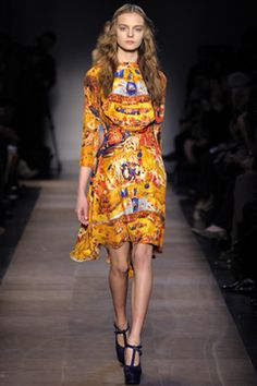 The rich golden yellow here is gorgeous.The prints here are inspired by Garden of Earthly Delights. French designer Carven. #FW2012 #PFW