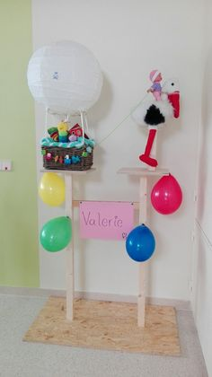 """Made this stand for baby present. Balloon is Ikea lantern shade and bathroom basket. I used plastic balloon holders four the """"ropes"""". Ikea Lanterns, Balloon Holders, Bathroom Baskets, Baby Presents, Ropes, Baby Freebies, Baby Giveaways, Newborn Baby Gifts"""