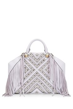 Rylan Tote - Made from soft pebbled leather in a geometric silhouette, this tote is the ideal go-anywhere bag. The fringe detailing gives it an utterly of-the-moment feel.
