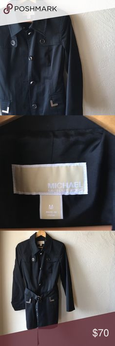 Michael Kora black short trench coat Great fall jacket. Tag says M can fit M or L. Long belt around waist with silver detail throughout. 2 for 15% off. Lmk any questions. Michael Kors Collection Jackets & Coats Trench Coats
