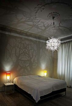 Branches+low-hanging light bulb=forest on your ceiling! Diycozyhome.com