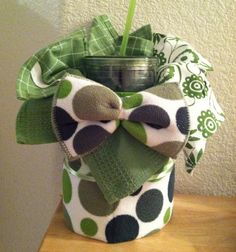 Tea Towel Cake made with 4 towels, dish mat and on the go cup