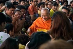 A monk blesses the crowd at the grand opening of Robinson Life Style Mall in Prachinburi, #Thailand, Dec. 04, 2014
