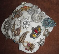 Used a small pillow and added vintage pins to it with clip-on earrings along the edge.