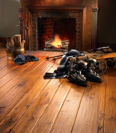 Hickory~  Wide Plank Hickory hardwood flooring crafted with a custom Hand-Scraped Face and Edge, and in random widths for a more casual look. Finished with a medium stain and Carlisle Amber finish. Installed on radiant heat.