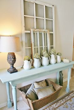Love the white pitchers and dried hydrangeas. -The Farmhouse Porch: Entry Way Refresh