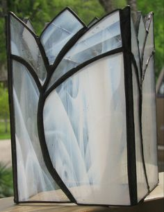 stained glass white candle holderby EleganceByHand on Etsy, $22.00.......photophore