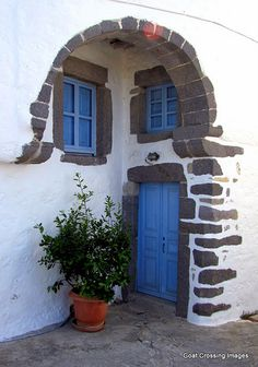 Blue door and windows in Chora - Island of Patmos, Greece