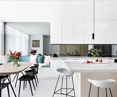 The owners of this beachside townhouse in Newcastle called local interior designer Stewart Horton to help them redesign their dated kitchen to create an open plan entertaining zone where the cook can enjoy the ocean views.
